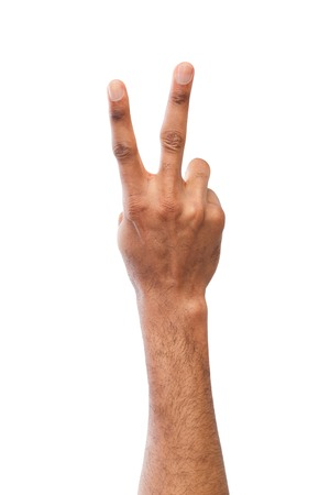 Black hand showing number two isolated. Counting gesturing, enumeration, white background