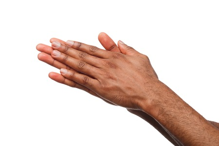 African-american male hands with palms rubbing together against white isolated studio background. Success or money anticipation Фото со стока