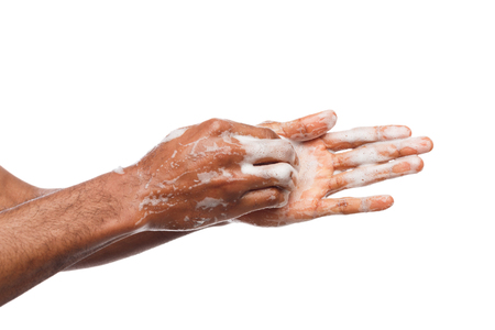 Black man washing hands isolated on white background. Hygiene, cleanliness concept