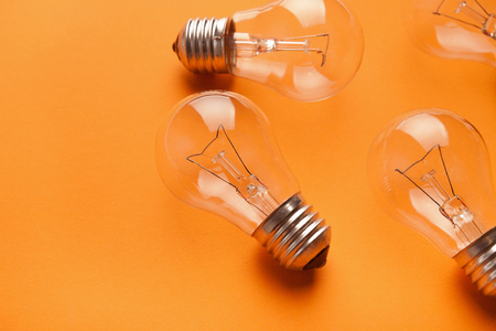 Light bulbs on yellow background with copy space, side view, closeup. Idea, inspiration and innovation concept