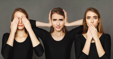 Set of feamle portraits gesturing see, hear and speak no evil. Collage of young woman emotions at gray studio background
