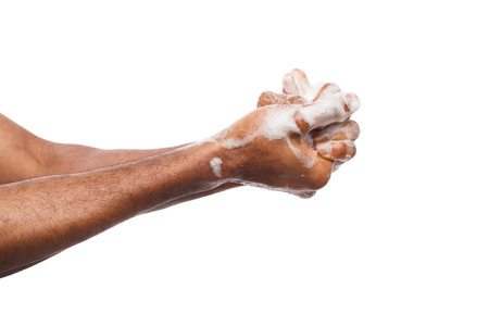 Black man washing hands with soap isolated on white background. Hygiene, cleanliness concept