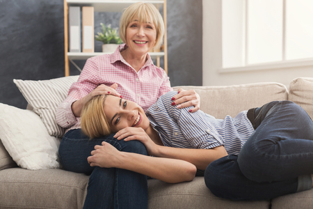 Adult mother calming down daughter, empathizing, sympathizing, spending time together at home on weekend. Generation and relationship concept Stock Photo
