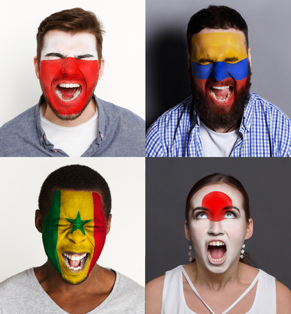 Emotional soccer fans with painted flags of Poland, Senegal, Columbia and Japan on faces. Rooters of football worldcup competition between rival countries of group H. Stock Photo