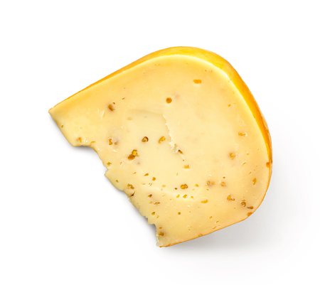 Piece of gouda cheese with spices isolated on white background, top view. Cutout for grocery store advertising