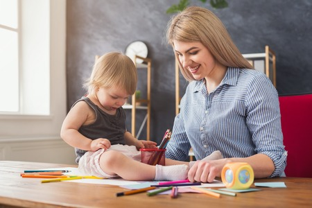 Happy mother playing and drawing with her cute daughter. Relationship, motherhood, trust, support, caress, maternal warmth, caring, education and early development concept
