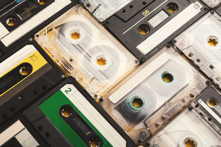 Music lovers background with retro audio cassette tapes. Closeup of vintage media devices, copy space on labels, flat lay Stok Fotoğraf