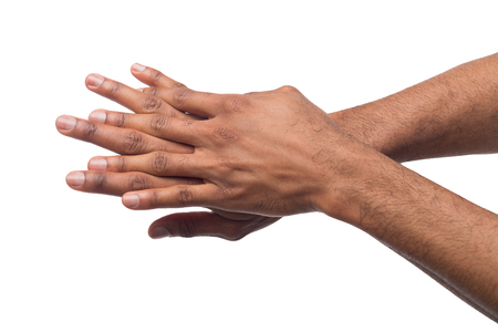 African-american male hands rubbimg together, applying moisturizing cream at white isolated background. Male cosmetology and skin care Imagens