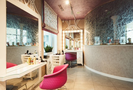 Interior of new modern beauty salon. Professional mirrors and chairs at empty hairdressers studio 版權商用圖片