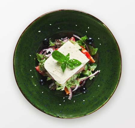 Spring vegetable salad, isolated on white. Top view of healthy restaurant food, cutout Stock Photo