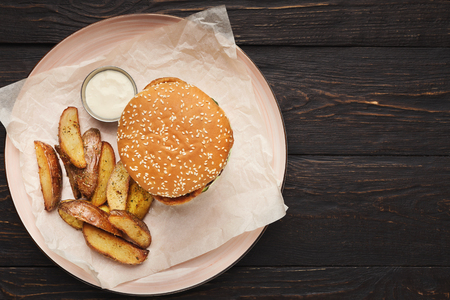 Street food set - hamburger, potato wedges and sause, top view, copy space Stock Photo
