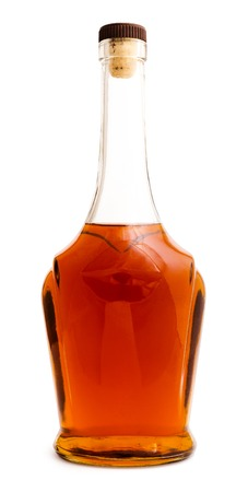 Full brandy bottle isolated on white background, cut out, no trade mark label, mockup