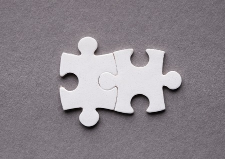 Two white joined puzzle pieces, mutual ideas and teamwork concept 版權商用圖片