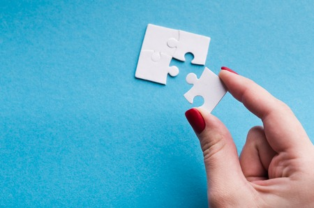 Last connecting piece jigsaw puzzle. Business connection, success and strategy concept, copy space Stock Photo