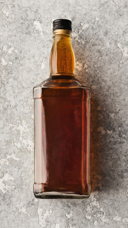 Blank bottle with whiskey or cognac