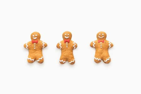 Three happy smiling gingerbread men isolated on white background