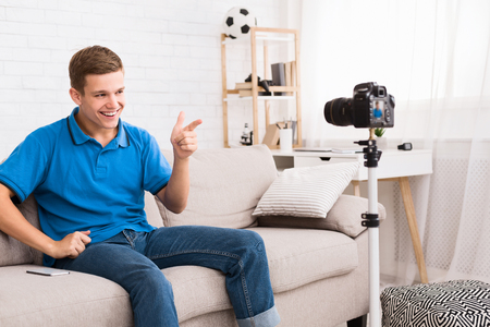 Young blogger. Teen guy recording video for new blog at home Stok Fotoğraf