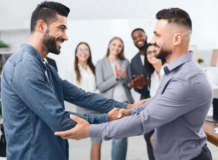 Two men shaking hands at business meeting