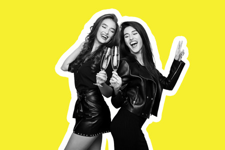 Magazine style collage portrait of two smiling female models clinking with champagne flutes on yellow background