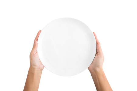 Woman holding empty plate waiting for food, isolated on white background, top view, copy space