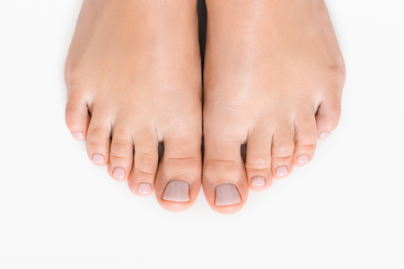 Female feet with pedicure after spa procedure isolated on white background, closeup