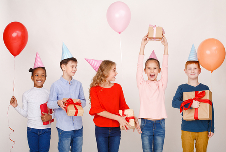Child friends having fun at birthday party over light background 版權商用圖片