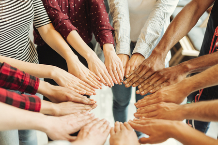 Group of hand touching together in circle shape, power of cooperation concept