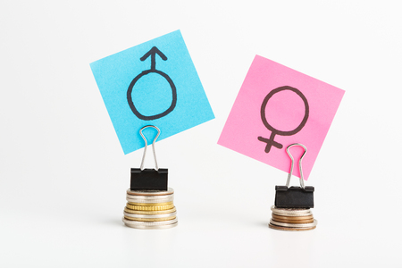 Illustration of gender pay gap, blue and pink stickers with male and female signs on stacks of coins, men get bigger salary