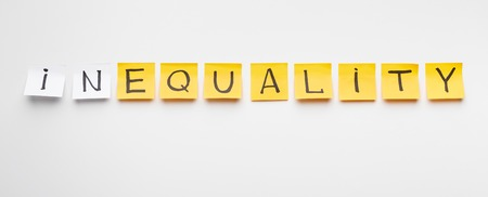 Inequality at business world. Word Equality written on yellow office stickers with particle In on white background, panorama