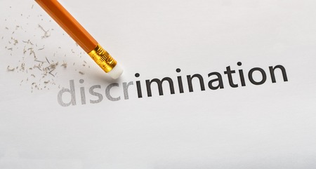 Equality concept. Erase word Discrimination with pencil eraser on white background, panorama Stock Photo