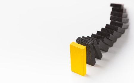 Corporate culture and discipline at work. Black wooden blocks following yellow leading one in strict order on white background, panorama, copy space