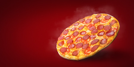 Hot smoked Italian pizza Diabolo in the air just from the oven, copy space, mockup. Some like it hot, fast delivery concept Banque d'images - 115833723