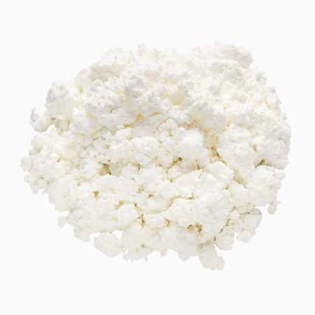 Cottage cheese heap isolated on white background 免版税图像