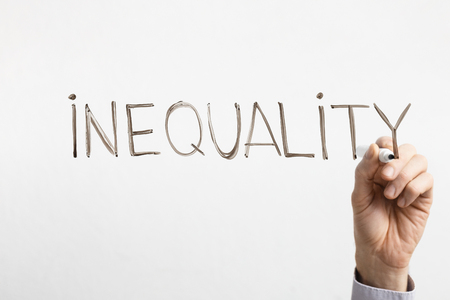 Stop gender discrimination. Man writing word Inequality on glass board, free space