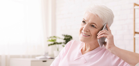 Nice free time. Attractive senior woman talking on mobile phone, panorama with empty space Stock Photo - 117788906