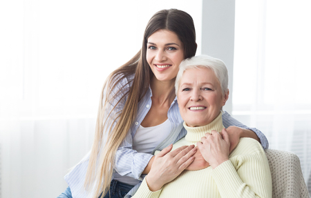 Mom, I love you. Happy daughter embracing her mother, enjoying time together Stock Photo