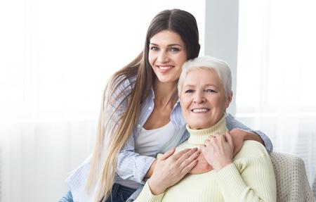 Mom, I love you. Happy daughter embracing her mother, enjoying time together Banco de Imagens