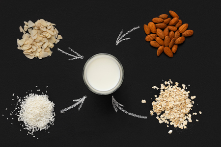 Collage of nuts, grains ,glass of milk with drawn arrows top view. Lactose free milk concept 스톡 콘텐츠