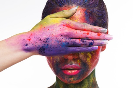 Beauty and art makeup concept. Fashion model woman with hand on face, covering eyes. Festive bodypaint