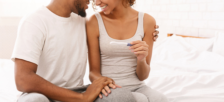 African-american couple in love enjoying positive pregnancy test at home, panorama with free space Reklamní fotografie