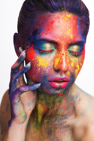 Cosmetics, make up, idea. Young woman with creative colorful bodypaint, closeup portrait