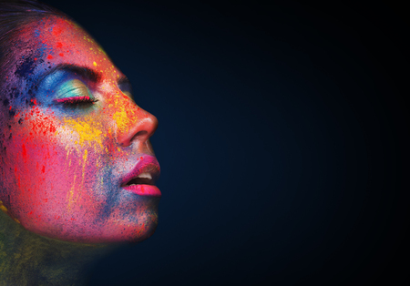 Satisfaction. Erotical portrait of young woman with colorful artistic makeup, closed eyes, black background with copy space