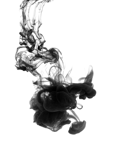 Black paint swirling in water on white background. Modern graphic concept