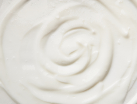 Sour cream texture background, top view