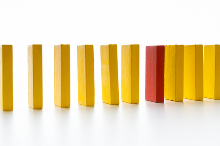 Ageism. Age discrimination shown with one red wooden block between yellow ones, top view Stockfoto