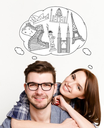 Happy couple on white background and cloud with tourist attractions above his head. Love and travel concept