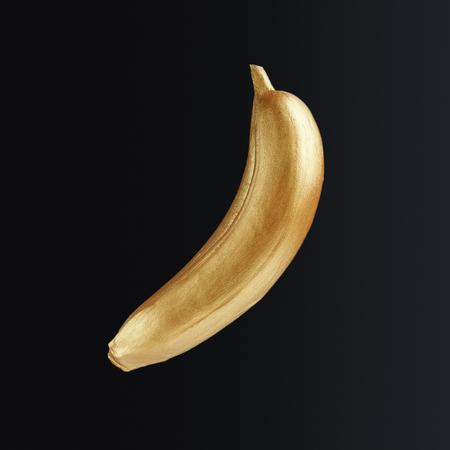 Golden banana isolated on black background. Golden fruits concept