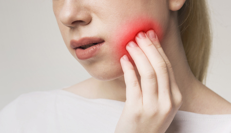 Tooth sensitivity. Woman suffering from toothache, touching inflamed cheek, panorama