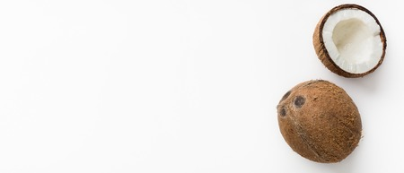 Whole coconuts and half on white background, top view, copy space 스톡 콘텐츠
