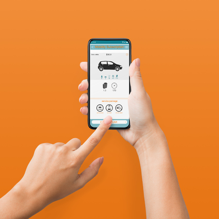Woman using cellphone with car rent app on screen, orange background, pov
